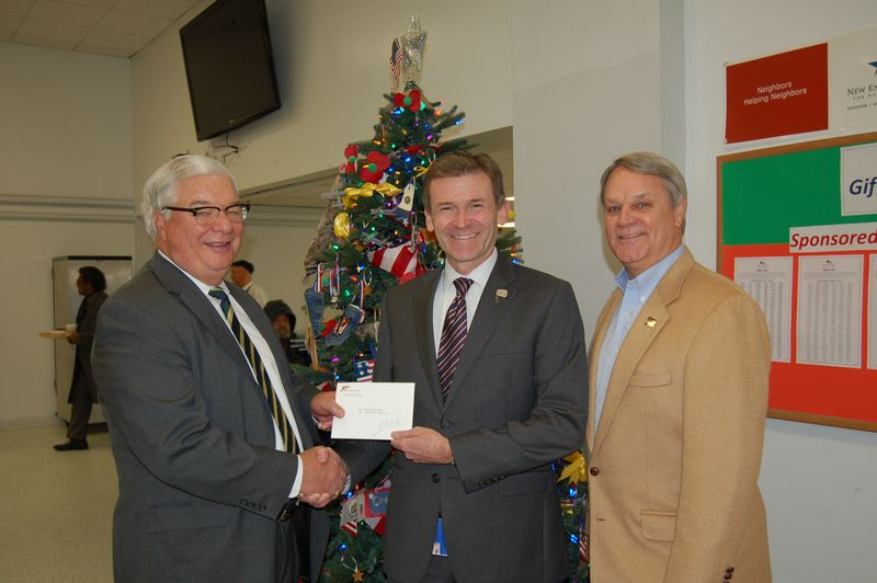 NECHV Check presentation with Center President and CEO Andrew McCawley